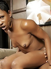 Ebony diva Diva Devine sits on top of our guys lap to ride his dick and gets a huge facial
