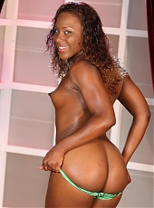 Black pornstar Ms Platinum posing and stripping her clothes during a live cam show